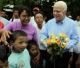 U.S. Senator John McCanin  accepts yellow roses from children carrying HIV virus during his visit to the shelter for AIDS patients run by Phyu Phyu Thin , Burma's well-known AIDS activist in Rangoon, Burma.