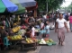 Vendors sell groceries on a road in downtown in Rangoon, Burma.