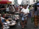 Vendors wait for customers as they sell fishes on a road in downtown in Rangoon, Burma.