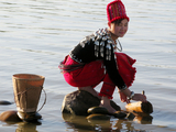 A Kachin girl fetches water from Myitson River in Myikyina in Kachin state, Northern Burma.