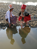 Kachin girls fetches water from Myitson River in Myikyina in Kachin state, Northern Burma.