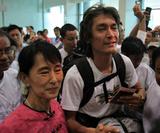 Burma pro-democracy leader Aung San Suu Kyi fetches her younger son, Kim Aris, at Yangon International Airport in Rangoon, Burma.
