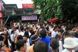 19-06-11 - PHOTO:- Irrawaddy Supporters of Burma pro-democracy leader Aung San Suu Kyi gather to celebrate her 66th birthday at the headquarters of National League for Democracy party in Rangoon, Burma.