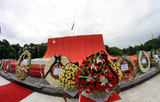 Tuesday, July.19, 2011, Yangon, Myanmar- Myanmar riot police remove barricades on road  to the Martyr's Mausoleum to give permission to the people to pay tribute to the nation's independence heroes at the mausoleum during  Martyr's Day ceremonies.