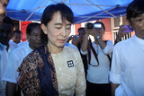 Myanmar democracy icon Aung San Suu Kyi attends the 23rd anniversary of the bloody uprising against the ruling junta in 1988 at a monastery in outskirts of Yangon Monday, Aug. 8, 2011, in Yangon Myanmar.