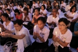 Activists pray at Botataung pagoda to release political prisoners on Sunday, Nov.20, 2011, in Yangon, Myanmar. About 200 activists take part in this event.