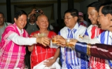 Aung Min (L) Minister of Railway and head of the negotiation group,General Mutu Saipo (2-L), representative of the Karen National Union (KNU) and Soe Thein (2-R), Minister of Industry and Khin Yee (R) Minister of Immigration toasts glasses during the dinner at the Hotel in Pa-an, capital of the Karen State, Myanmar,Wednesday  11 January 2012.