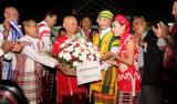KNU representative, Gen.Mu Tu and his fellows revceive the gift basket, Pa-an, Karen State, Myanmar, 11 Jan 2012