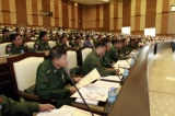 Military representative swear during a session at parliament buildings in Naypyitaw, Myanmar, Monday, April.23, 2012.