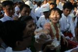 16-04-12 NLD leader, Daw Suu Kyi and party members donate food to supporters supporters during Burmese New Year day celebrations in Yangon, Myanmar.