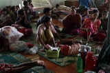 Refugee camp (a Monastery) and damaged buildings in Sittwe, Rakhine State, Saturday, June.16, 2012.