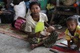 Gunshots rang out and residents fled blazing homes in western Myanmar on Tuesday as security forces struggled to contain deadly ethnic and religious violence that has killed at least a dozen people and forced thousands to flee, 12 June 2012, Rakhine State, Myanmar.