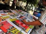 03-04-12 photo Kyaw Zwa Moe Burmese print media and newspapers on sale.