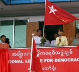Myanmar opposition leader Aung San Suu Kyi, center, attends an opening ceremony of a branch office of her National League for Democracy party on Wednesday, 15 August 2012, Naypyidaw, Myanmar.
