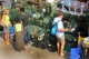 01-03-12 - Photo Jpaing Tourists enjoy shopping at a street stall in Burma