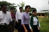 10-10-12 - PHOTO - Khin Maung Win Myanmar pro-democracy leader Aung San Suu Kyi visit BEHS Kaw-Hmu and meets with teachers and students Wednesday, in Yangon, Myanmar.