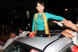04-10-12 - Suu Kyi returns from USA - PHOTO khin Maung Win Myanmar pro-democracy leader Aung San Suu Kyi greets supporters from her vehicle on her arrival at Yangon International Airport after she came back from US Tour Thursday, Oct.4, 2012, in Yangon, Myanmar.