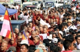 12-12-12 - Monks protest - PHOTO - Khin Maung Win Buddhist monks protest against the Monywa copper mine  and subsequent attack on protesters  by police, at Sula Pagoda in downtown Rangoon