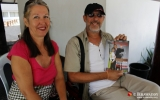 22-12-12 - Irrawaddy mag - PHOTO - Jpaing Tourists with a copy of the first Irrawaddy Magazine in Rangoon