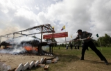 26-06-13 Photo Irrawaddy Police and officials conduct a public destruction of drugs on World Drug Day