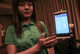 CB Bank employee explain system of  mobile banking at yangon, sedona hotel.