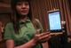 CB Bank employee explain system of  mobile banking at yangon, sedona hotel.