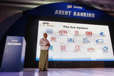 U Kyaw Lynn explain system of  mobile banking at yangon, sedona hotel.