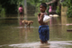 Children walking on a flooded water in Hlegu at the Yangon region of Myanmar.