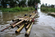 Children's paddles a makeshift bamboo raft on a flooded water in Hlegu at the Yangon region of Myanmar.