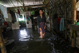 Local residents flooding on water in Hlegu at the Yangon region of Myanmar.