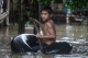 A boy playing by riding on life-buoy on 6th August as the houses from certain wards in Bago Region were floated due to the heavy rain and unusual tide.