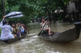 People making their ways with boat on 6th August as the houses from some wards in Bago Region were floated due the heavy rain and unusual tide.