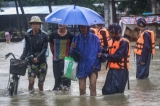 The auxiliary firefighter squad helping out the elderly people on 6th August as the houses from some wards in Bago Region were drowned due to the heavy rain and unusual tide.