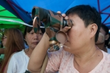 A woman using telescope to observe the Dammasaydi Bell salvation project site near   Shu Khin Thar recreation zone in Thaketa Township, Yangon on 27th August morning (Photo – Sai Zaw/ Irrwaddy)