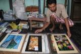 04-09-14 Photo: JPaing Burmese artist San Zaw Htway takes a break in his studio in Rangoon