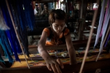Woman make cotton weaving at Myitkyina in Kachin State. ( Photo - Thaw Hein Htet / The Irrawaddy)