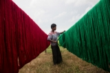 Man drying cotton for kachin weaving at Myitkyina in Kachin State. ( Photo - Thaw Hein Htet / The Irrawaddy)