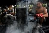 Man making cotton for kachin weaving at Myitkyina in Kachin State. ( Photo - Thaw Hein Htet / The Irrawaddy)