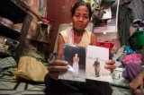 Mya Mya Win, the older sister of Aye Aye Sint, the victim of electric shock showing her sister's photo. (Photo – Sai Zaw/ Irrawaddy)