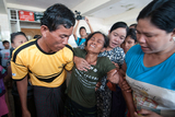 Mya Mya Win, the older sister of Ma Aye Aye Sint who was the victim of electric shock, crying at her sister's funeral held on 14th September. (Photo- Sai Zaw/ Irrawaddy)