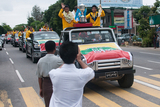 The fans cheering at the vehicle that carried the Myanmar National Footbal Team, the champion of Philippines Peace Cup to Thuwunna Footaball Stadium from Yangton International Airport. Myanmar got a draw result when playing against the Philippines National Team at their home. Myanmar National Team became Champion with Soe Min Oo, the substitute player scored a goal during the extra time. (Photo – Sai Zaw/ Irrawaddy)