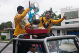 The Team Captain Khin Maung Lwin, the Striker Kyaw Ko Ko and the Philippines Peace Cup on the vehicle that would go around the Yangon City celebrate the victory. Myanmar got a draw result when playing against the Philippines National Team at their home. Myanmar National Team became Champion with Soe Min Oo, the substitute player scored a goal during the extra time. (Photo – Sai Zaw/ Irrawaddy)