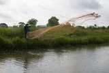 A resident from Toon Tay Township fishing with casting net at a stream in Toon Tay Township which lies on the other side of Yangon City and where 'Yangon New Town Plan' is said to be implementing within September. (Photo – Sai Zaw/ Irrawaddy)