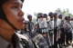 Police officers stand guard at a barricade leading to a monastery preventing the students from proceeding with a protest march to in Letpadan, March 2. 2015. ( Photo - JPaing / The Irrawaddy)