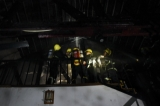 A fire broke out at a building on lower block of Maha Bandoohla Street in Kyauktada Township in downtown Rangoon on March 1 evening. The mezzanine on the top floor of the building caught fire and firefighters had to climb up to the roof of the building to put out the fire. The mezzanines of the two rooms at the top floor were damaged in the fire. (Photo: Sai Zaw/The Irrawaddy)
