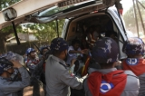 Police beating injured students inside an ambulance in Letpadan on March 10. (Photo: Sai Zaw/The Irrawaddy).