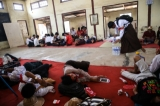 Student protesters rest in a monastery after police surrounded the monastery preventing them from proceeding with a protest march to Yangon from Letpadan, March 2. 2015. ( Photo - JPaing / The Irrawaddy)