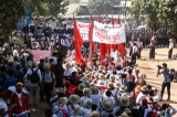 Student protesters shout slogans at the standoff in front of a monastery in Letpadan March 3. 2015. ( Photo - JPaing / The Irrawaddy)