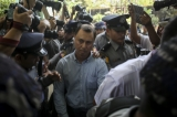 V Gastro Bar owner Tun Thurein, manager Htut Ko Ko Lwin and New Zealand national general manager Philip Blackwood, who used a Buddha image wearing headphones for promotion was sentenced to two-and-a-half-year in prison with hard labor on March 17, 2015. (Photo: Thaw Hein Htet/The Irrawaddy)