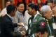 General Gun Maw, left, the KIA chief of staff, shakes hands with Lt-Gen Myint Soe, third left, as the government's lead peace negotiator Aung Min, second left, looks on. (Photo: JPaing / The Irrawaddy)